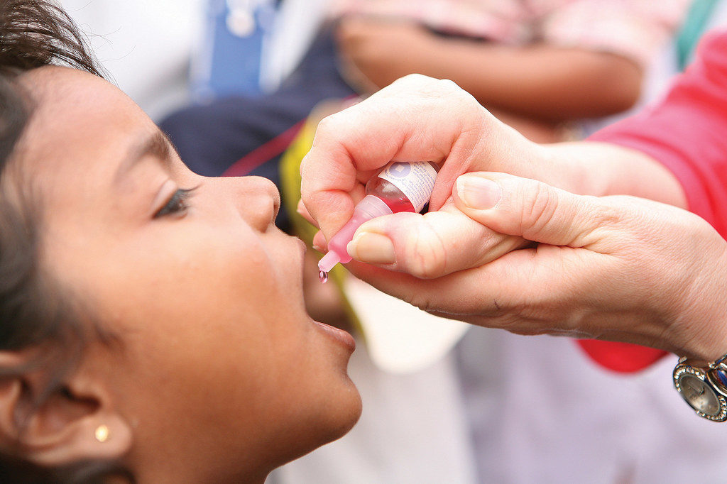 Image of child getting oral polio vaccine