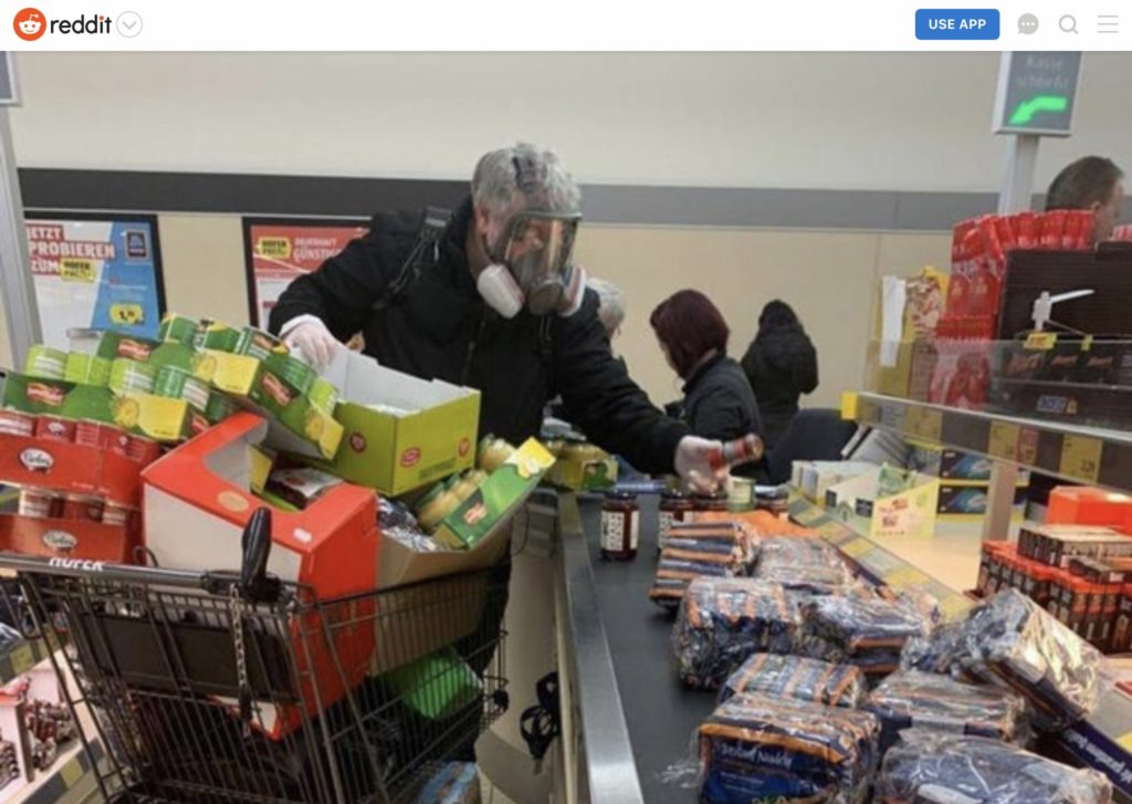 Guy in gas mask buying groceries