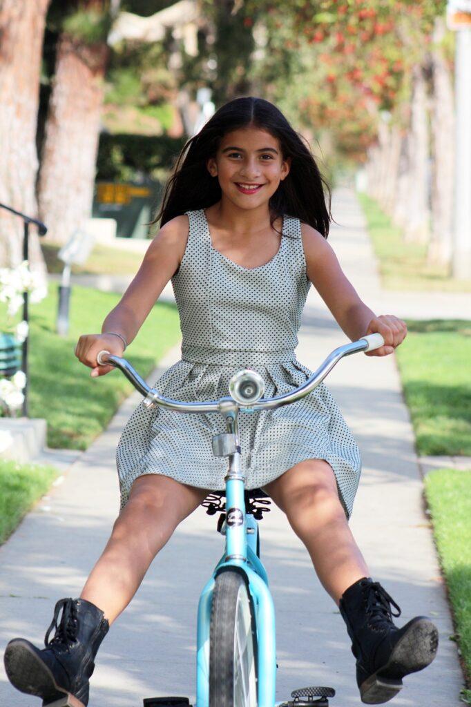 Pre-teen riding bike